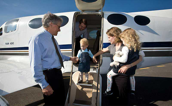 Family disembarking private charter flight with Adirondack Flying Service