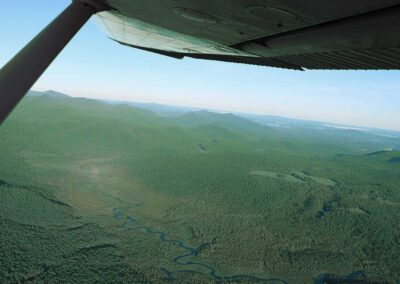 Scenic flight over a winding river in the Adirondacks
