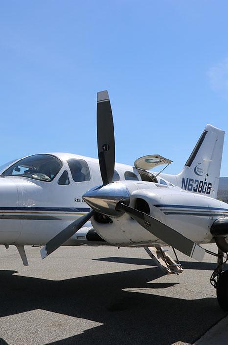 Cessna 421 with door open for maintenance