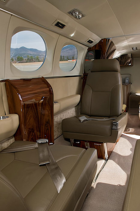 Leather and wood interior of private charter plane
