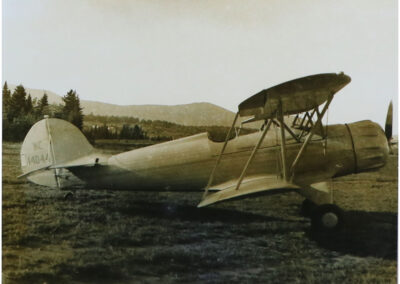 An open cockpit biplane in the 1930's